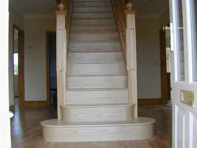 Hardwwod flight of stairs with a bottom bullnose tread